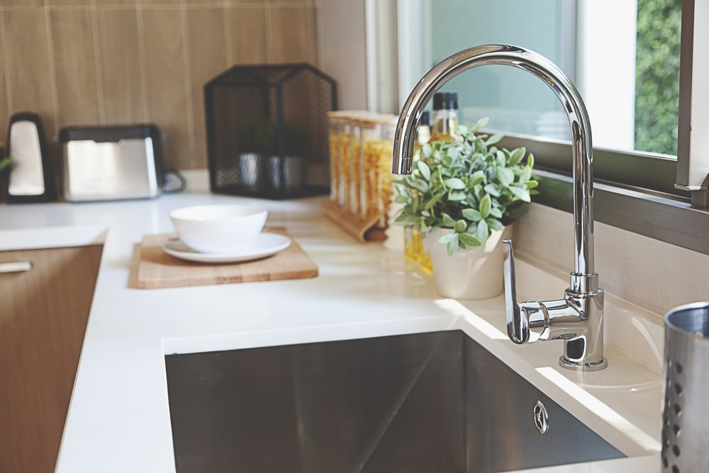 Kitchen tap in stainless steel